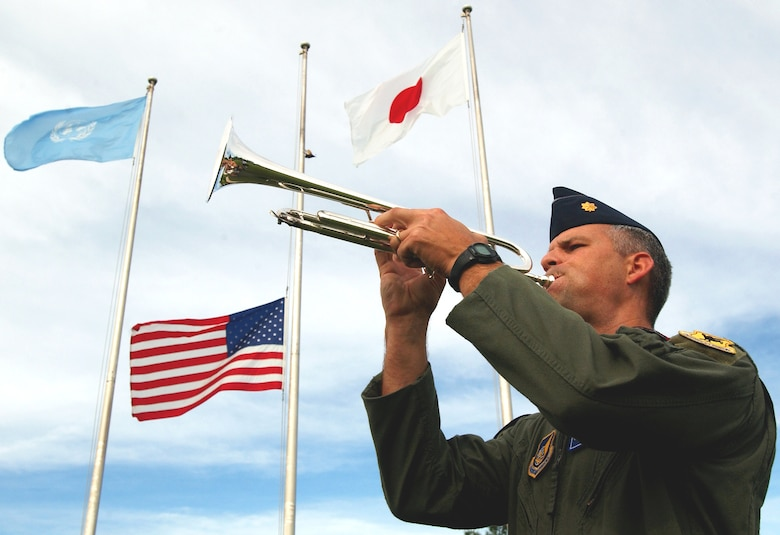 Maj. Jason Settle, 18th Wing Inspector General chief of wing exercises, plays Taps during the 9/11 memorial ceremony on Kadena AB, Japan, Sept. 11, 2007. (U.S. Air Force photo/Tech. Sgt. Reynaldo Ramon)