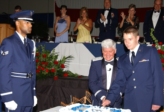 Maj. Gen. Allan R. Poulin, Air Force Reserve Command vice commander, and Airman Basic Greg A. Harper, 439th Aircraft Maintenance Squadron, cut the cake at Westover's 60th Anniversary of the Air Force military ball Sept. 8.