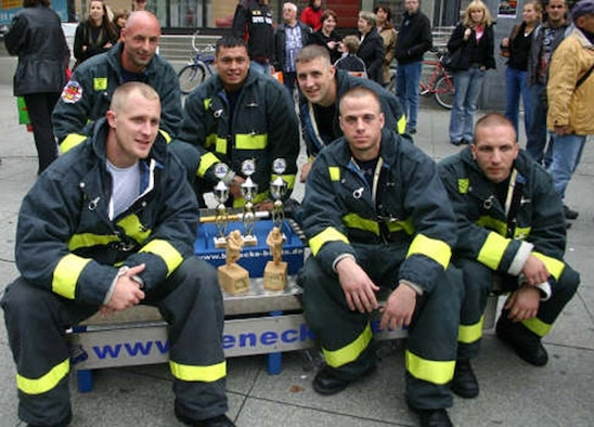 SPANGDAHLEM AIR BASE, Germany – Members of the 52nd Civil Engineer Squadron fire department take a moment to relish in their achievements at the Berlin Firefighter Combat Challenge where they competed against 65 fellow firefighters from Sweden, England, Poland, Russia, Germany and the United States Sept. 8. The firefighters took home 11 awards. (Courtesy photo)