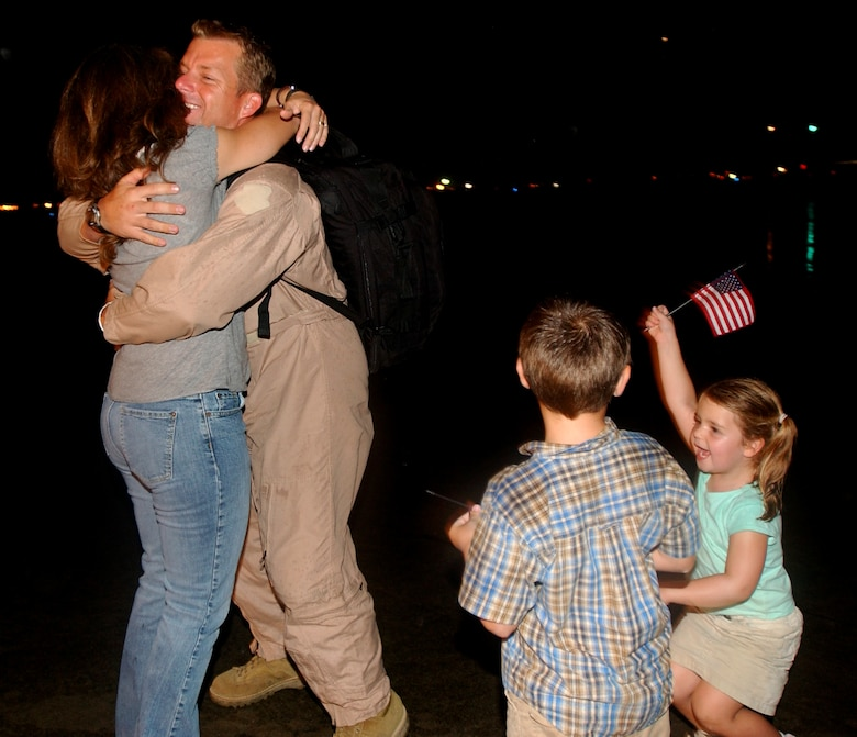 After being deployed for four months, a Master Sgt. from the 31st Rescue Squadron, is met by his wife Wendy and their two children after landing at Kadena AB, Japan, Sept. 10, 2007. (U.S. Air Force photo/Tech. Sgt. Rey Ramon)