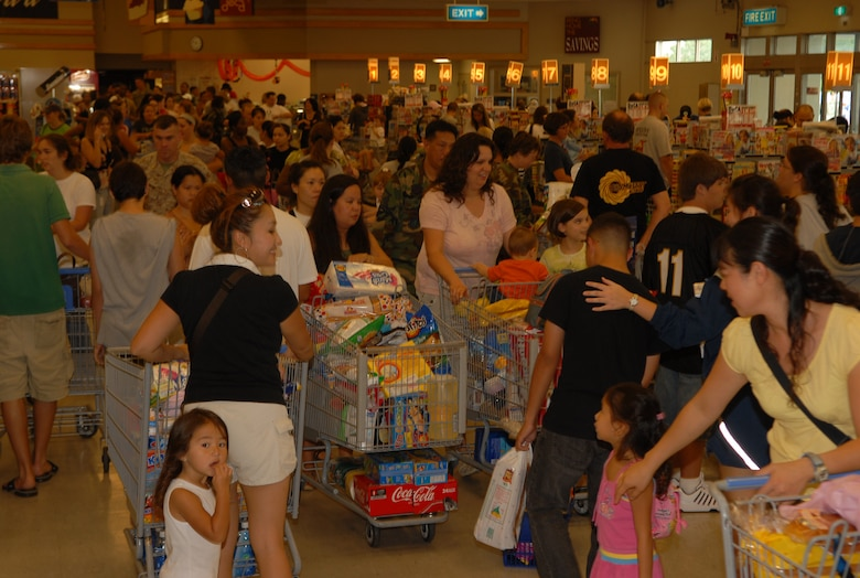 Shoppers rush to buy food and supplies at the commissary at Kadena Air Base, Japan, Sept. 14, 2007 in preparation for Typhoon Nari. The base prepared itself for typhoon by moving jets and equipment from the flightline into protective aircraft shelters. The typhoon will hit the island the evening of Sept. 14 with 45 knot winds gusting to 65 knots. (U.S. Air Force photo/Junko Kinjo)