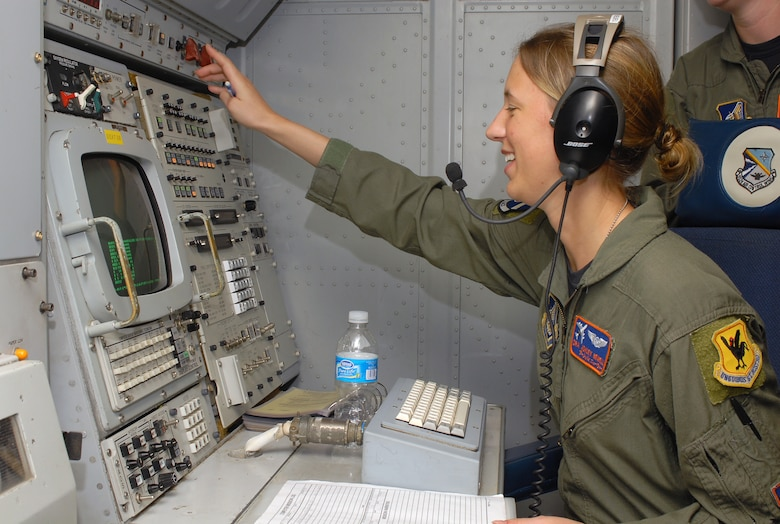 Senior Airman Ashley Newell documents any system malfunctions so that they can be trouble shot before the E-3 Airborne Warning and Control System's (AWACS) next flight at Kadena Air Base, Japan, Sept. 11, 2007.  The AWACS' primary mission is to provide surveillance, command and control and airborne management.  Airman Newell is from the 961st Airborne Air Control Squadron.  (U.S. Air Force photo/Airman 1st Class Kelly Timney)