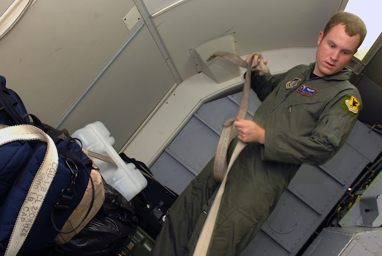 Senior Airman Michael Klouda secures baggage during the preflight inspection of the E-3 Airborne Warning and Control System (AWACS) before it takes off in support of the 18th Operations Group Turkey Shoot at Kadena Air Base, Japan,  Sept. 11, 2007.  The Turkey Shoot is an annual event where all squadrons compete against each other to determine who's the best in the wing.  Airman Klouda is from the 961st Airborne Air Control Squadron.  (U.S. Air Force photo/Airman 1st Class Kelly Timney)