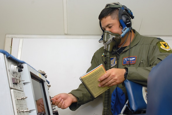 Capt. Brandon Dong tests his oxygen mask during the preflight inspection of the E-3 Airborne Warning and Control System (AWACS) before it takes off in support of the 18th Operations Group Turkey Shoot competition at Kadena Air Base, Japan, Sept. 11, 2007.  The Turkey Shoot is an annual event where all squadrons of the wing compete against each other to determine who's the best.  Captain Dong is from the 961st Airborne Air Control Squadron.  (U.S. Air Force photo/Airman 1st Class Kelly Timney)