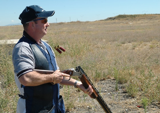 FAIRCHILD AIR FORCE BASE, Wash. -- Master Sgt. Dale Brunelle, 92nd Aircraft Maintenance Squadron section chief, empties the spent cartridges out of his competition shotgun while practicing at the sports range here. While on the practice range, Sergeant Brunelle makes every shot count in his quest to regain the title of best shooter in the Air Force. (U.S. Air Force photo / Tech. Sgt. Larry W. Carpenter Jr.)