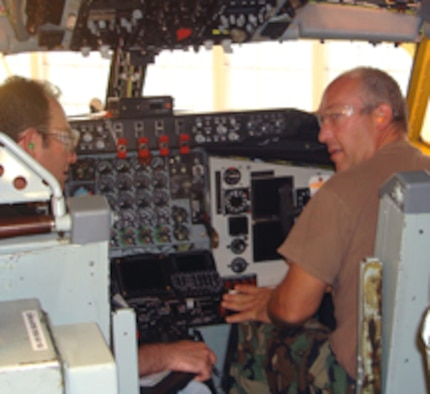 Craig Wiggins and Tech Sgt. Joe Hanson ensure the KC-135 flight deck is fit to fly and meets all quality inspection requirements. (Air Force photo)