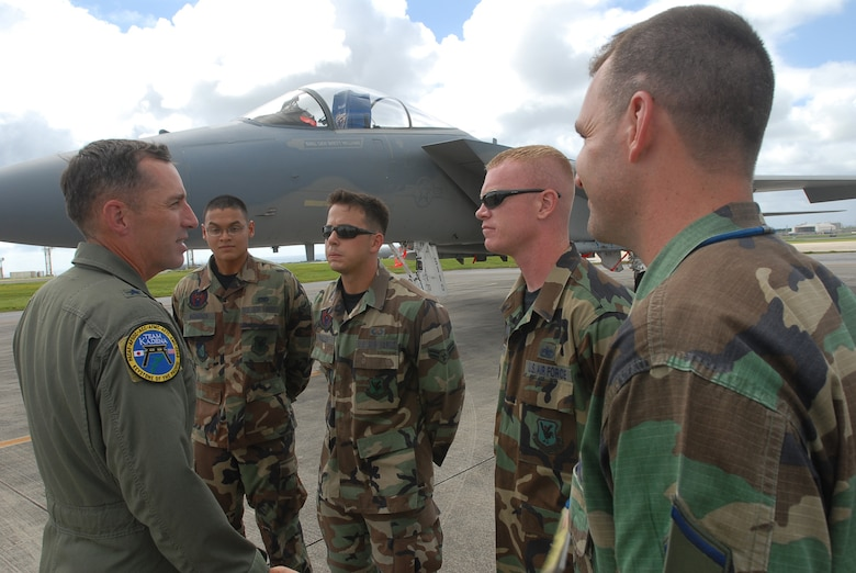 Brig. Gen. Brett Williams speaks with Airman Mauricio Agueros, Airman 1st Class Cody Waller, Staff Sgt. Kirk Smith, and Master Sgt. David Wade  during a visit to his dedicated crew chiefs at Kadena Air Base, Japan, Sept. 12, 2007.  The general is the 18th Wing commander and all four Airmen are dedicated crew chiefs with the 18th Aircraft Maintenance Squadron 44th Aircraft Maintenance Unit. (U.S. Air Force Photo/Senior Airman Darnell T. Cannady)