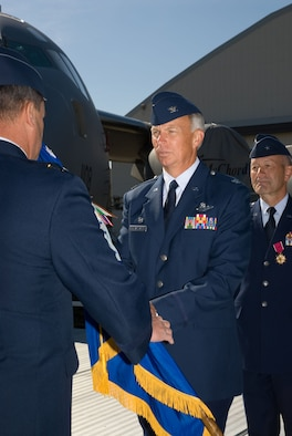 The new 446th Airlift Wing commander, Col. William Flanigan, accepts the wing's flag during the change of command ceremony Sept. 9 at McChord Air Force Base, Wash.  Colonel Flanigan last served as commander of the 939th Air Refueling Wing, Portland, Ore.  Brig. Gen. Eric Crabtree, outgoing 446th AW commander, will take command of the Air Reserve Personnel Center, Denver, Colo., where he will oversee personnel issues of Guard and Reserve Airmen. (U.S. Air Force photo/Tech. Sgt. Eli Yamzon)
