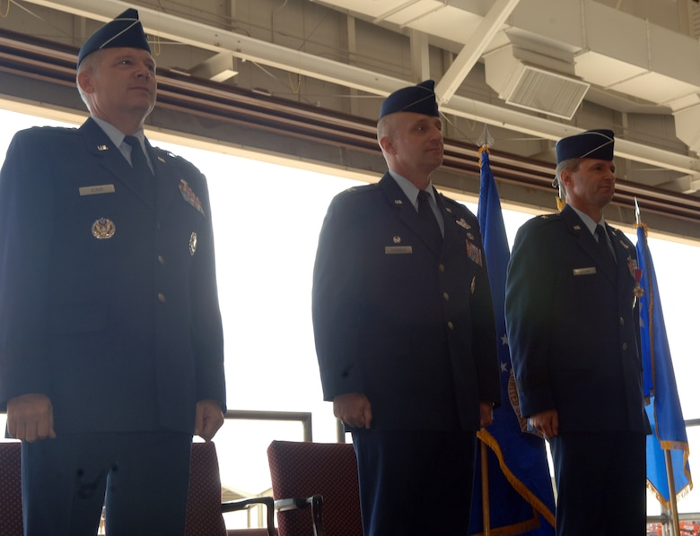 WHITEMAN AIR FORCE BASE, Mo. -- (Left to right) Lt. Gen. Robert Elder Jr., 8th Air Force commander, Col. Garrett Harencak and Brig. Gen. Greg Biscone, stand at attention while the men and women of the 509th Bomb Wing sing the Air Force Song during the 509th Bomb Wing change-of-command ceremony Sept. 14. Colonel Harencak took command of the 509th BW from General Biscone during the ceremony. General Biscone travels to MacDill Air Force Base, Fla., to become the deputy commander of Operations at U.S. Central Command. (U.S. Air Force photo/Staff Sgt. Felicia Haecker)
