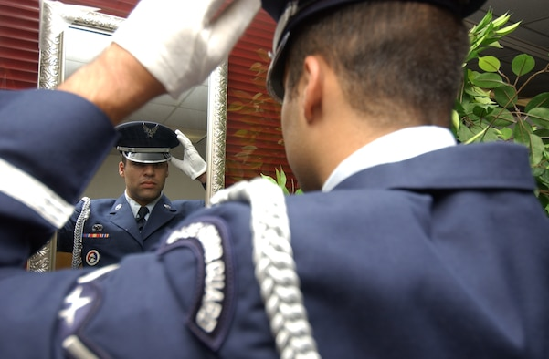 Airman Salanitri makes sure his honor guard uniform looks perfect.