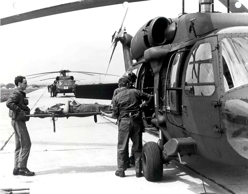 "U.S. Army Blackhawk helicopters move ""wounded"" Airmen from Aviano Air Base, Italy to Vicenza, Italy during Exercise Lightning Response in 1986. Prevalent terrorist activity throughout the Mediterranean in the 1980s spurred U.S. Air Forces in Europe to revise its quick-response medical organizations.  From June 3 through 12,  Aviano Air Base hosted several U.S. Air Force and Army medical teams in responding to a simulated terrorist attack. (Courtesy photo)"
