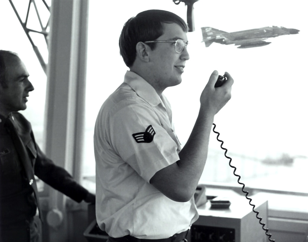 Senior Airman Bob Wisniewski directs air traffic control operations at Aviano Air Base, Italy in 1978 as Lt. Col. Gene DiBartolo, the 40th Tactical Control Group's deputy commander watches. An F-4 Phantom  is seen in the control tower window. (Courtesy photo)