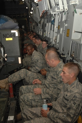 SEYMOUR JOHNSON AFB, N.C. ? Airmen from the 4th Fighter Wing wait in a C-17 for their departure on Sept. 14, 2007 at Seymour Johnson AFB, N.C.  The Airmen are deploying to Southwest Asia in support of the Global War on Terror.  (US Air Force photo by Senior Airman Chad Trujillo)(released)