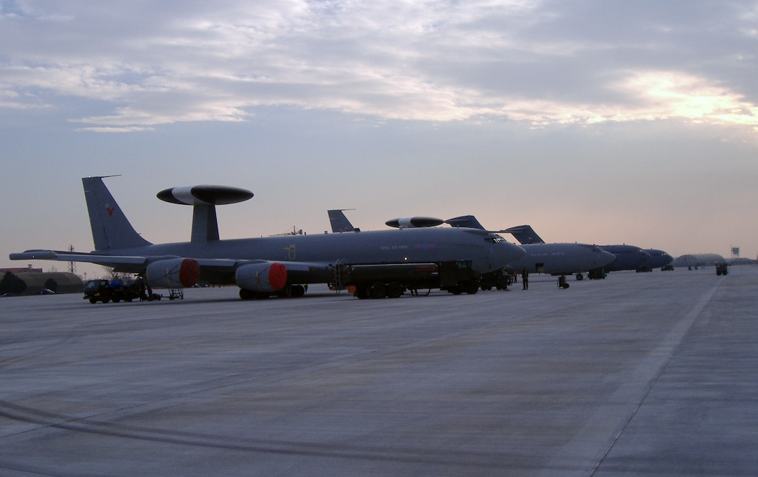 Two NATO E-3 AWACS sit on the new south ramp at Aviano Air Base, Italy.  The NATO aircraft were providing overflight protection for the Winter Olympics at Torino, Italy in 2006. (Courtesy photo)