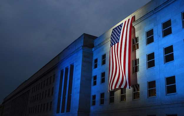 A memorial flag is illuminated near the spot where American Airlines Flight 77 crashed into the Pentagon on Sept. 11, 2001. (U.S. Navy photo/Petty Officer 1st Class Brandan W. Schulze)