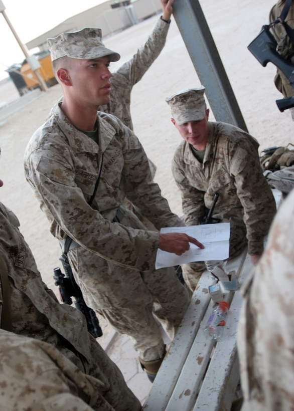 Cpl. Harold D. Applegate, of West Allis, Wis., a Howitzer cannoneer with Battery B, Battalion Landing Team, 3rd Battalion, 8th Marine Regiment, 22nd Marine Expeditionary Unit (Special Operations Capable), briefs his squad on an upcoming mission while his platoon is conducting Military Operations in Urban Terrain training aboard Camp Buehring, Kuwait, Sept. 17, 2007. Btry. B is practicing infantry tactics in case they are called into action to serve as a provisional rifle company. The Marines and sailors of BLT 3/8 currently act as the Ground Combat Element of the 22nd MEU(SOC) on a scheduled deployment. (Official U.S. Marine Corps photo by Cpl. Peter R. Miller)