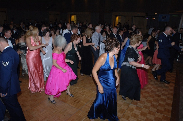 """HILL AIR FORCE BASE, Utah-- Team Hill members dance the night away after the official portion of the Hill Air Force Base """"Heritage to Horizons"""" Air Force 60th Anniversary ball held at the Eccles Conference center. (U.S. Air Force photo by Alex R. Lloyd)"""