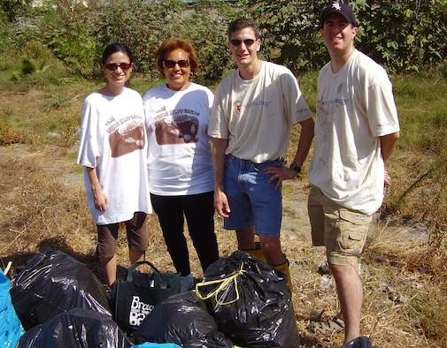 Volunteers from SMC joined with other companies and community groups in a recent Coastal Cleanup Day organized by Heal the Bay and sponsored by Southern California Gas Company.  Pictured at the Compton Creek cleanup site are (l-r); Maj. Cecilia Brawner, Compton Council Member Yvonne Arceneaux, TSgt. Mike McGeever, and Maj. Sean Rucker. Two-hundred volunteers picked up six dump truck loads of trash.