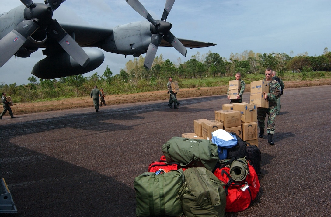 PUERTO CABEZAS, Nicaragua – Soldiers and Airman offload supplies from C-130 Sept. 14.  The C-130, assigned to the 908th Airlift Wing at Maxwell Air Force Base, Ala., delivered a P-19 fire truck and firefighters from Soto Cano Air Base, Honduras, to support hurricane relief operations here.  (U.S. Air Force photo by Tech. Sgt. Sonny Cohrs)
