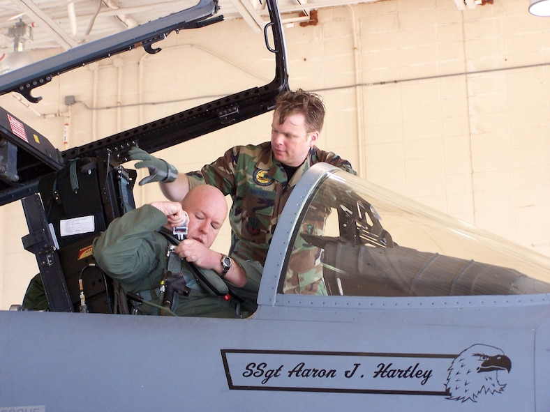 Capt. Todd Pearson, 390th Fighter Squadron pilot from Mountain Home Air Force Base, Idaho, is assisted by Staff Sgt. Aaron Hartley, a Florida Air National Guard 125th Fighter Wing, Detachment 1, crew chief during the Celestial Eagle Remembrance Flight at Homestead Air Reserve Base, Fla. Captain Pearson's father, retired Maj. Gen. Doug Pearson, flew the exact same F-15, now assigned to the 125th FW, exactly 22 years prior while accomplishing the only successful satellite kill by an aircraft launched missile in history. Sergeant Hartley came up with the idea while researching the history of the F-15s assigned to the 125th FW. (U.S. Air Force photo/Senior Airman Erik Hofmeyer)