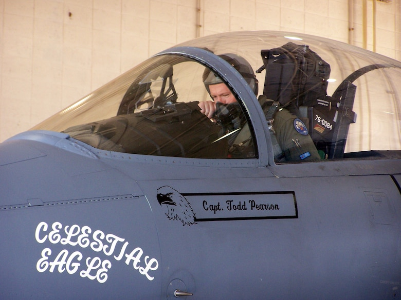 Capt. Todd Pearson, 390th Fighter Squadron pilot from Mountain Home Air Force Base, Idaho, performs pre-flight checks on an F-15A at the Florida Air National Guard 125th Fighter Wing located at Homestead Air Reserve Base, Fla., during the Celestial Eagle Remembrance Flight on Sept. 13. Captain Pearson's father, retired Maj. Gen. Doug Pearson, flew the exact same F-15, now assigned to the 125th FW, exactly 22 years prior while accomplishing the only successful satellite kill by an aircraft launched missile in history. (U.S. Air Force photo/Senior Airman Erik Hofmeyer)
