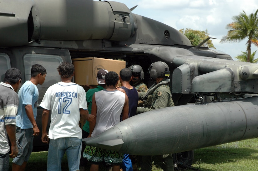 PUERTO CABEZAS, Nicaragua –  Aircrews from Joint Task Force Bravo in Honduras distribute relief supplies Sept. 15 in small communities along the coast near Puerto Cabezas, Nicaragua.  The U.S. State Department and Department of Defense are working together to bring food, water and other needed items to small communities on the Nicaraguan coast that were affected by the hurricane.  (Army photo by Specialist Grant Vaught)