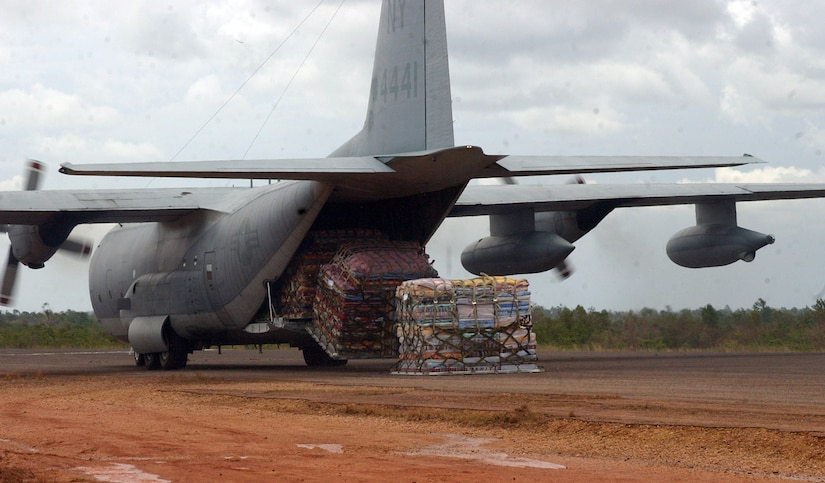 PUERTO CABEZAS, Nicaragua - A Marine Corps KC-130 offloads six pallets of beds donated by El Salvador in Puerto Cabezas, Nicaragua, Sept. 16.  The Marine KC-130 is part of U.S. relief efforts in Nicaragua in the wake of Hurricane Felix.  The U.S. State Department and Department of Defense are working together to bring food, water and other needed items to small communities on the Nicaraguan coast that were affected by the hurricane.  (Air Force photo by 1st Lt. Erika Yepsen)