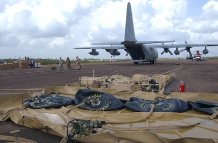 PUERTO CABEZAS, Nicaragua – A U.S. Marine Corps KC-130 assigned to the Marine Aerial Refueler Transport Squadron 452 (VMGR-452), delivers fuel for hurricane relief missions following landfall of Hurricane Felix.  The KC-130 pumped 3,500 gallons of jet fuel into an Advanced Aviation Forward Area Refueling System here that was set up by soldiers from the 1st Battalion, 228th Aviation Regiment from Joint Task Force-Bravo at Soto Cano Air Base, Honduras.  (U.S. Air Force photo by Tech. Sgt. Sonny Cohrs)