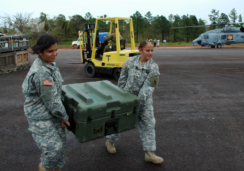PUERTO CABEZAS, Nicaragua – Specialist Guadalupe Rodriguez and Sgt. Lisena Cruz move equipment to help set up a command and control center here Sept. 15.  Both women are deployed here from Joint Task Force Bravo in Honduras to help support Hurricane Felix relief operations.  The U.S. State Department and Department of Defense are working together to bring food, water and other needed items to small communities on the Nicaraguan coast that were affected by the hurricane.  (Army photo by Specialist Grant Vaught)