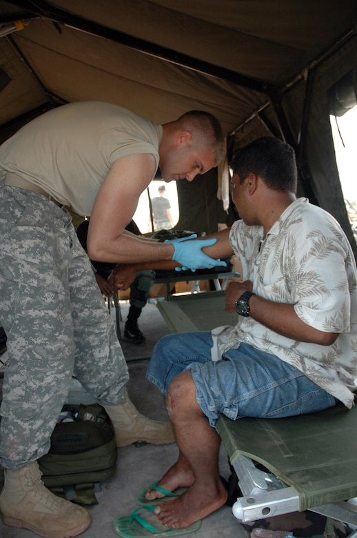 PUERTO CABEZAS, Nicaragua – Army medic Spc. Jonathan Potter provides medical care to a local man who was injured by flying debris on the flightline here Sept. 15.  Specialist Potter is part of a team deployed from Joint Task Force Bravo in Honduras to provide relief in Nicaragua after Hurricane Felix.  The U.S. State Department and Department of Defense are working together to bring food, water and other needed items to small communities on the Nicaraguan coast that were affected by the hurricane.  (Army photo by Specialist Grant Vaught)