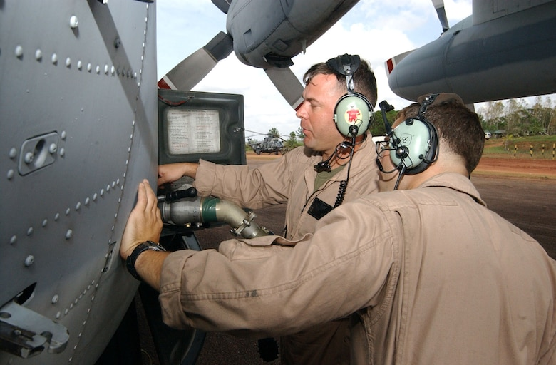 PUERTO CABEZAS, Nicaragua – Marine Staff Sgt. Charles Miller (left) and Marine Corporal Ethan Moore, both assigned to the Marine Aerial Refueler Transport Squadron 452 (VMGR-452), connect a fuel hose to a KC-130 here Sept. 15.  The KC-130 pumped 3,500 gallons of jet fuel into an Advanced Aviation Forward Area Refueling System here that was set up by soldiers from the 1st Battalion, 228th Aviation Regiment from Joint Task Force-Bravo at Soto Cano Air Base, Honduras, to support aircraft flying relief missions following Hurricane Felix.  (U.S. Air Force photo by Tech. Sgt. Sonny Cohrs)