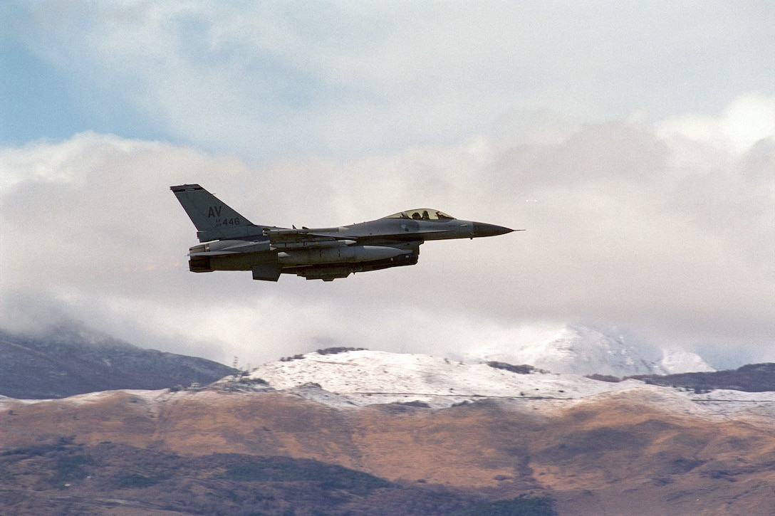 A F-16 Fighting Falcon flies over Aviano Air Base, Italy, as it departs for an NATO Operation Allied Force mission in the Balkans March 27, 1999. (U.S. Air Force photo/Senior Airman Mitch Fuqua)
