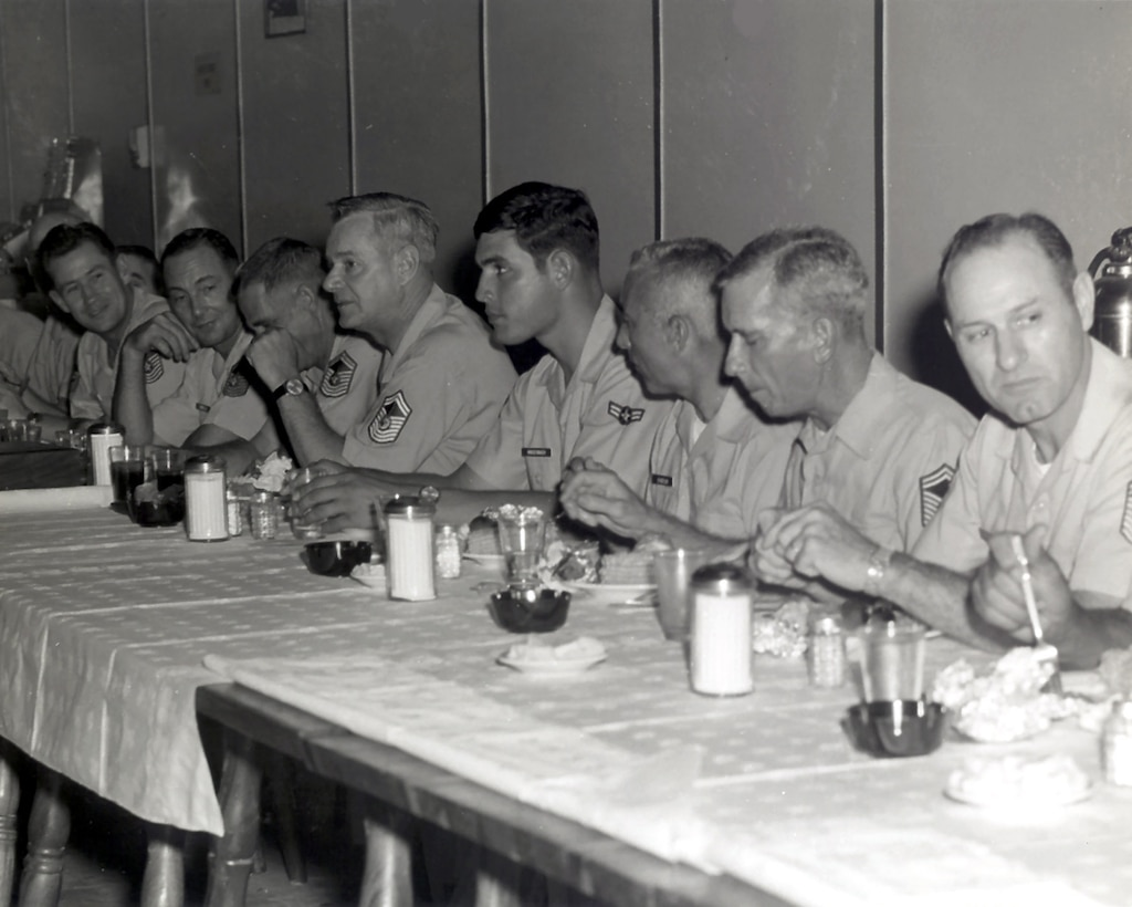 The Air Force's first Chief Master Sgt. of the Air Force, Paul Airey, [fifth from right] chats with Airmen Nov. 2, 1968 at the Noncommissioned Officers Club at Tuy Hoa Air Base, South Vietnam. The 31st Tactical Fighter Wing was the host unit at Tuy Hoa. (Courtesy photo)