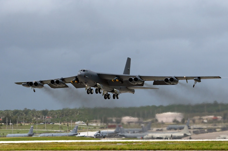 A B-52 bomber, deployed at Andersen Air Force Base, Guam, from Barksdale Air Force Base, La., takes off for September's Koa Lightning exercise.  For the first time, B-52 crews dropped inert munitions on Pele Bombing Range, Hawaii.  The munitions are made from concrete and have GPS guidance, which make them safe for the environment. This training provides valuable simulated combat experience for the aircrews and translates into raw global combat power against the continuing war on terrorism. (U.S. Air Force photo/Senior Master Sgt. Mahmoud Rasouliyan)