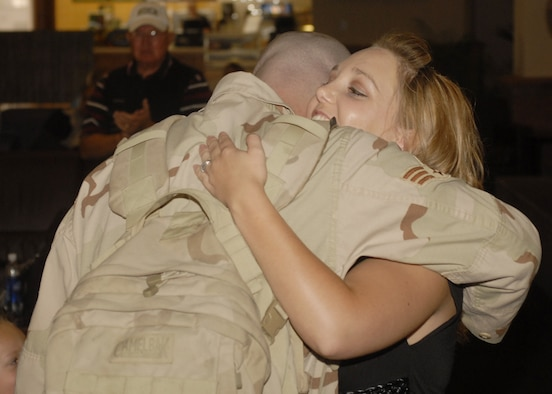 Senior Airman David McDonald hugs his wife Jenny after returning from Iraq Sept. 14. Airman McDonald was one of a dozen members of the 21st Security Forces Squadron returning from a six-month deployment. (U.S. Air Force photo by Larry Hulst)