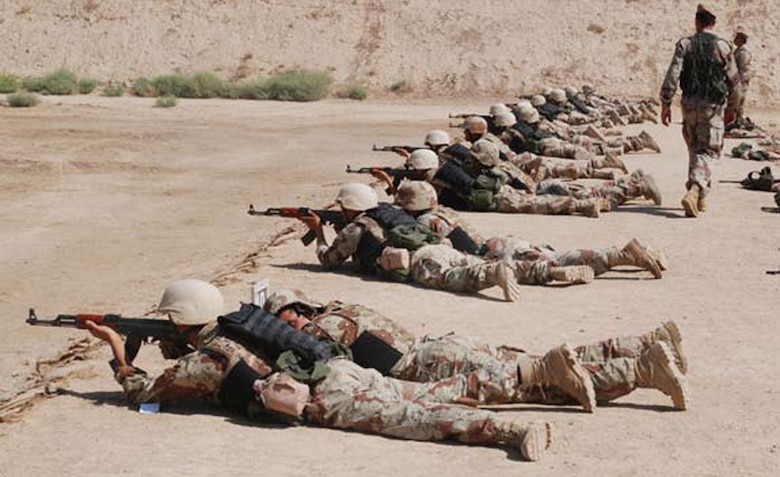 AR RUSTAMIYAH, Iraq - Senior term cadets practice their marksmanship and leadership skills during a course at the IMAR firing range. One student coached, while the other fired. (U.S. Air Force photo / Senior Airman Christie Putz)