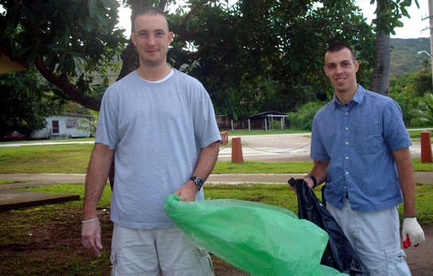 Capt. Ken Hills (right) and 1st Lt. Ben Poole participate Sept. 15 in the annual coastal cleanup in Guam. Both are currently deployed to the 20th Expeditionary Bomb Squadron at Anderson Air Force Base, Guam. Eight members of the unit volunteered to spend their off-duty time assisting the local populace during the annual event geared toward preserving the island's natural beauty. (U.S. Air Force photo/1st Lt. Tiffany Bares)