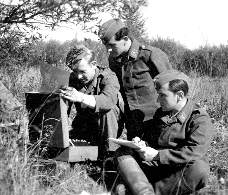 Luftwaffe troops use an Enigma machine. One man types while another records the enciphered or deciphered letters. (Photo courtesy of Helge Fykse, Norway)