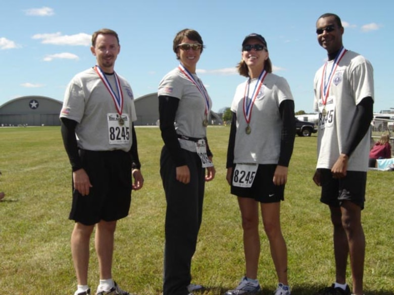 AF OSI Special Agents Dave Yeager, Carolyn Rocco, Elizabeth Richards and Anthony Parkinson competed as a team in the Air Force Marathon Sept. 15, in memory of seven agents killed in the line of duty.