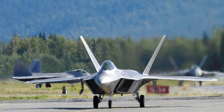 F-22 Raptors taxi following touchdown at Elmendorf Air Force Base, Alaska, during a ceremony marking the aircraft's arrival Aug. 8. Under an associate unit relationship, the regular Air Force's 3rd Wing and Air Force Reserve Command's 477th Fighter Group will fly and maintain the aircraft. The 477th FG is AFRC's first F-22 unit. (Tech. Sgt. Keith Brown)
