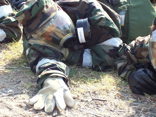 ANDREWS AIR FORCE BASE, Md. -- An Airman in full mission-oriented protective posture gear lays close to the ground during a alarm red ground attack in a mass casualty exercise here Sept. 9. (U.S. Air Force photo/Senior Airman Jessica Andrews)