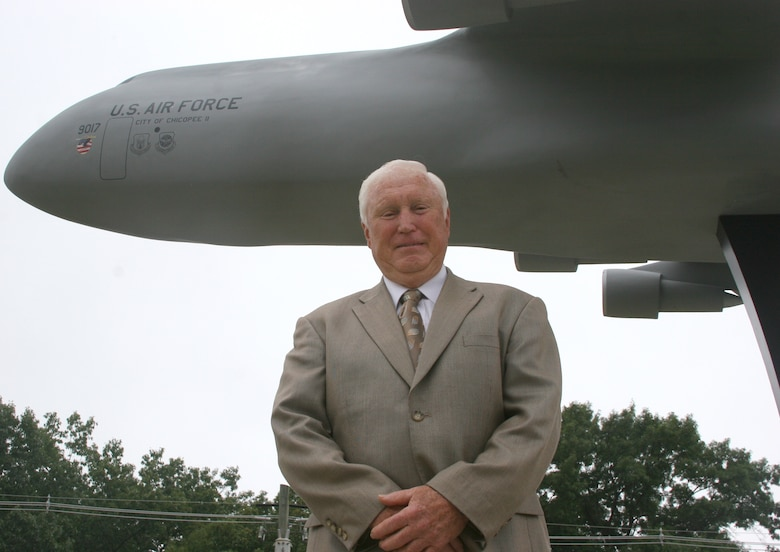 Retired Brig. Gen. Frederick ?Mike? Walker,? former 439th Airlift Wing commander, stands next to the C-5 model near the front gate. General Walker, who led the wing during the C-5 conversion in 1987, visited the base on the A UTA and delivered his remarks at the unveiling of the model, which is among five installed on the base depicting famous military aircraft assigned to Westover. The other aircraft models are a B-52D, KC-135A, C-130E, and a C-123K. (US Air Force photo/Tech. Sgt. Robert Cirillo)