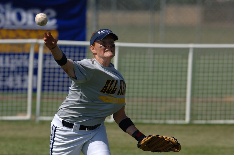 HILL AIR FORCE BASE, Utah-- Navy Seaman Jamie Strum makes a throw in an attempt to strike out her opponent during the All-Armed Forces Women's Softball Championships The championships were held at Hill Air Force Base, Utah, Sept. 18-21. (U.S. Air Force photo by Alex R. Lloyd)