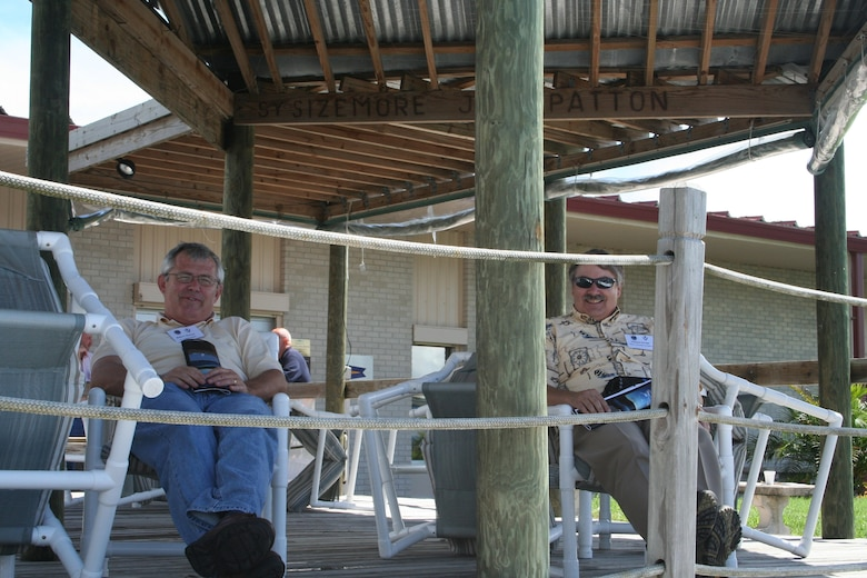 PATRICK AFB, Fla. - Wright-Patterson AFB Civic Leaders Robert Murray, left, and Michael Savage, right, take a moment before lunch to relax on the deck at the Patrick AFB, Fla. Marina.  The 445th Airlift Wing and the 88th Air Base Wing hosted the civic leaders on a C-5 Galaxy flight to Patrick AFB, Fla. to enhance community awareness of the total force mission. (U.S. Air Force photo/Laura Darden)