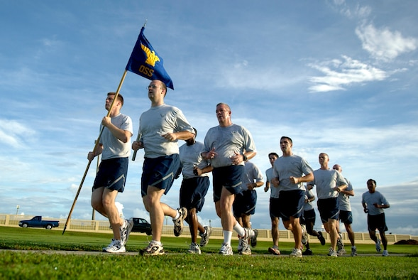 Members of the 36th Operations Support Squadron run in formation around the Arc Light Memorial during the Prisoner of War and Missing in Action Run, Sept. 21, 2007. Squadrons base-wide participated in the 24-hour run on POW/MIA Recognition Day. (U.S. Air Force photo/Senior Airman Miranda Moorer)