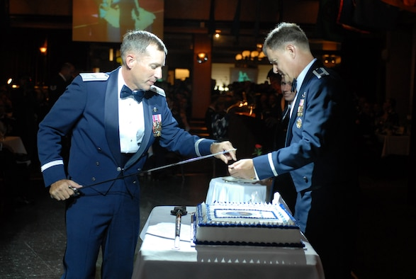 Brig. Gen. Brett T. Williams, 18th Wing commander and Col. John Harris, 18th Mainenenance Group commander, prepare to cut the cake during the Air Force's 60th Anniversary Ball at Kadena Air Base, Japan, Sept. 22, 2007.  The evening consisted of toasts, video presentations, guest speakers, skits and live music.  More than 800 military members and their guests from all four services, the local community and Japanese Self Defense Force attended the annual event.  (U.S. Air Force photo/ Airman 1st Class Kelly Timney)