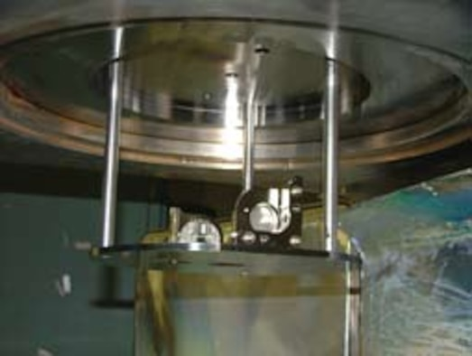 Intrachamber instrument mounted inside a vacuum chamber