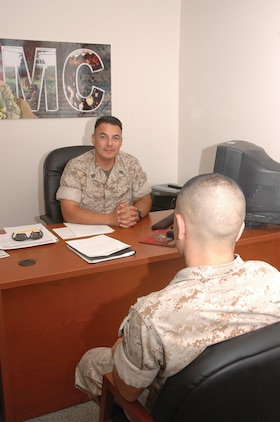 Gunnery Sgt. Johnny Garcia, Headquarters & Headquarters Squadron legal chief, counsels another Marine Sept. 24 here. Garcia believes Hispanic Heritage Month is something to take pride in and that people need to always remember their family and culture.