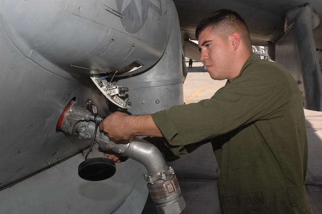 Lance Cpl. Mauricio Herrera, Marine Attack Squadron 311 powerplant mechanic, refuels an AV-8 Harrier Sept. 24 here. Hispanic Heritage Month, celebrated Sept. 15 through Oct. 15, is a recognition of the culture, contributions and heritage of Hispanic Americans in the Marine Corps.