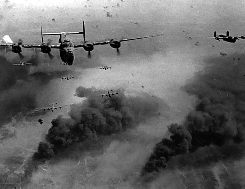 A formation of B-24 Liberators conduct a bombing mission over occupied Europe during World War II.  (U.S. Air Force photo)